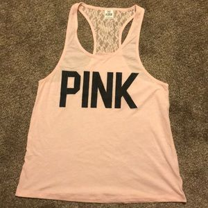 {pink} light pink razor back tank